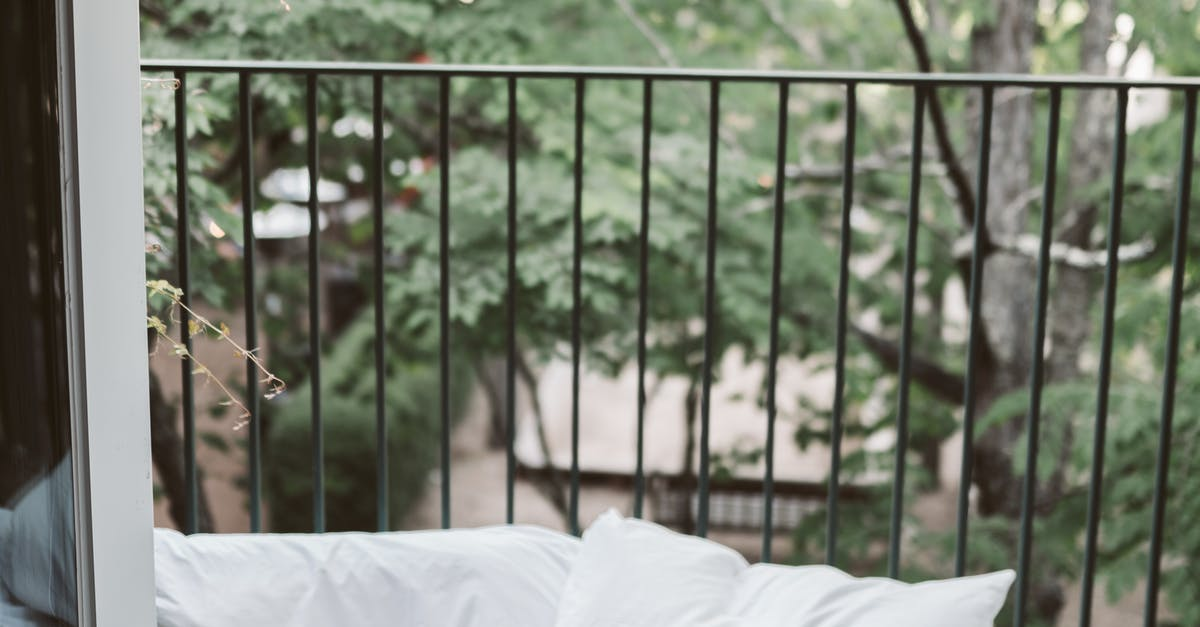 A bed with a wooden fence
